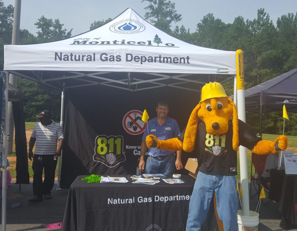 Digger with City of Monticello Gas Department's Richard Martin