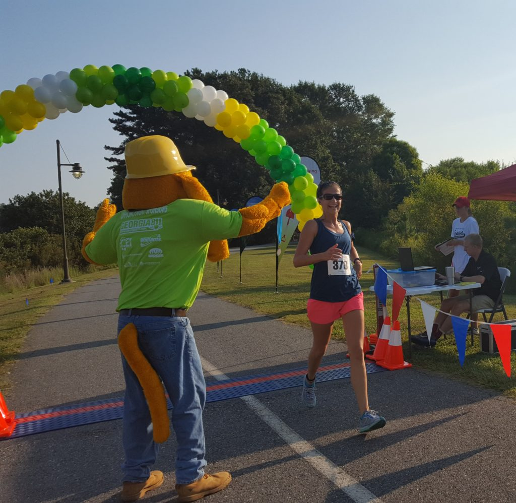 Digger cheering the first place women to finish the 5K