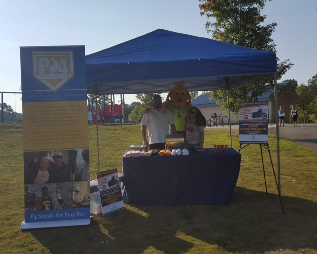 Digger at the P4 Foundation that helps childhood cancer patients' booth