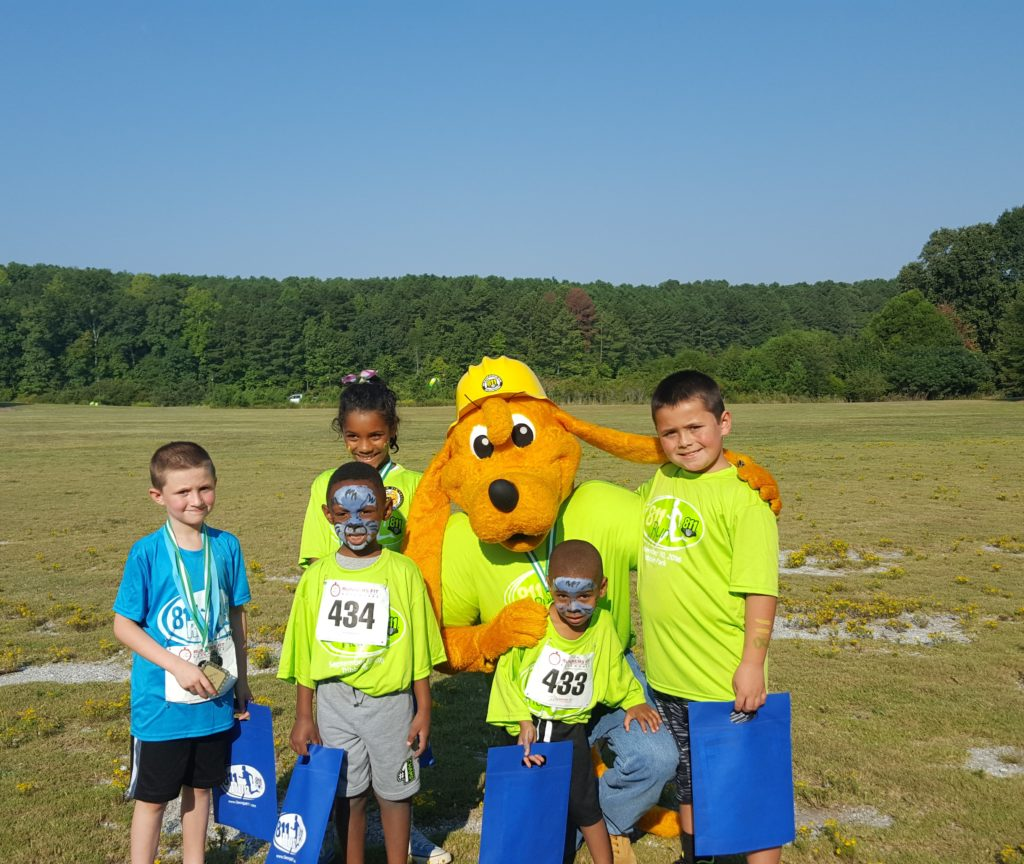 Digger with the participants of the kids race